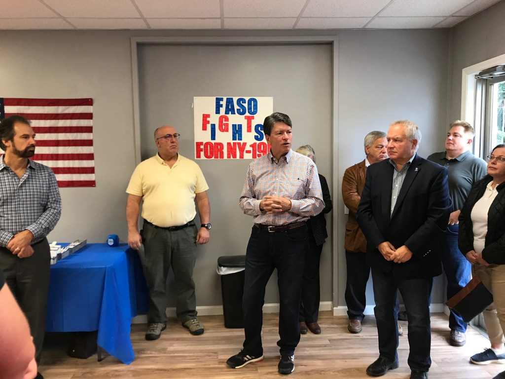 Faso speaks with supporters at a campaign office in Hyde Park. (Bridget Bowman/CQ Roll Call)