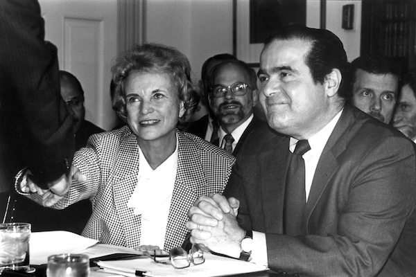 Supreme Court Justice Sandra Day O'Connor greets Sentor Rudman as Justice Scalia looks on. This photo was tken on 05-07-92 during an Approp. Subcommittee.