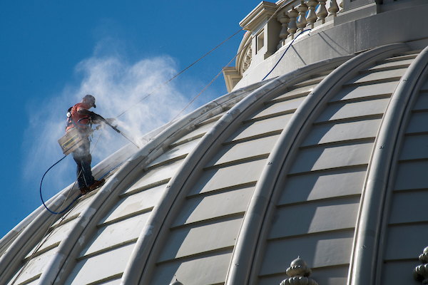 UNITED STATES - OCTOBER 3: A worker uses a pressure washer on near the top of the U.S. Capitol dome on Wednesday, Oct. 3, 2018. (Photo By Bill Clark/CQ Roll Call)
