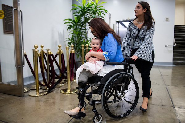 Sen. Tammy Duckworth, D-Ill., and her daughter Maile move through the Senate subway on Thursday morning, Oct. 4, 2018. (Photo By Bill Clark/CQ Roll Call)