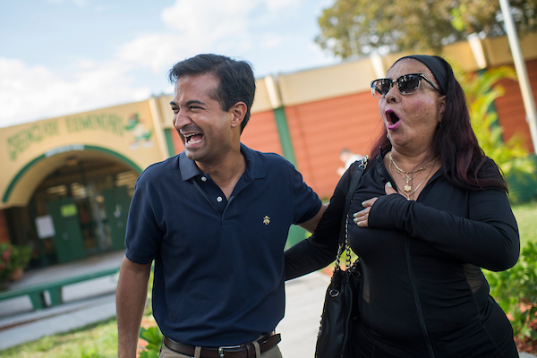 Rep. Carlos Curbelo, R-Fla., of Florida''s 26th District, talks with voters at the Greenglade Elementary School polling place on Election Day in Kendale, Fla. (Tom Williams/CQ Roll Call)