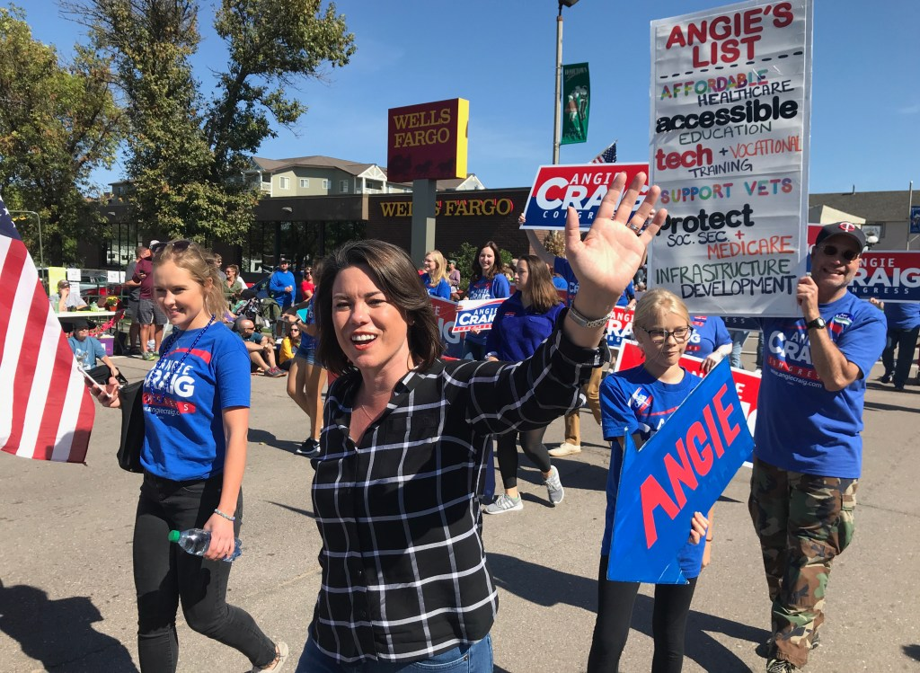 UNITED STATES - SEPTEMBER 22: Angie Craig, Democratic candidate for Minnesota's 2nd Congressional District, campaigns during a parade in New Prague, Minn., on September 22, 2018. (Photo By Simone Pathe/CQ Roll Call)