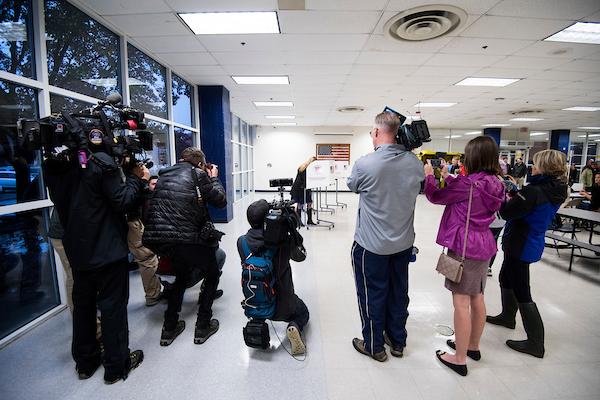 UNITED STATES - NOVEMBER 6: Media surrounds Jennifer Wexton, Democratic candidate for Virginia's 10th district, as she votes at Loudoun County High School in Leesburg, Va., on election day, Nov. 6, 2018. (Photo By Bill Clark/CQ Roll Call)