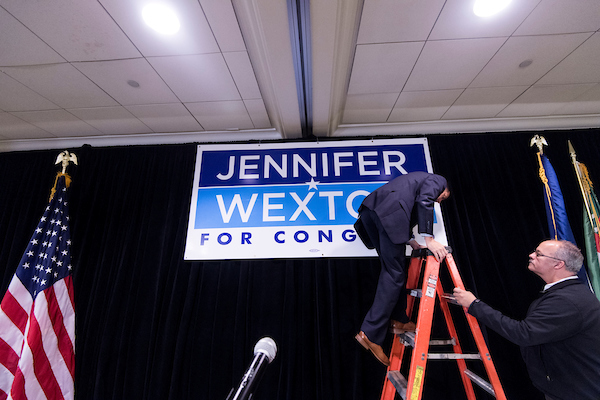 Hotel workers finsih hanging a Jennifer Wexton campaign on stage for Wexton's election night party in Dulles, Va. on Nov. 6, 2018. (Photo By Bill Clark/CQ Roll Call)