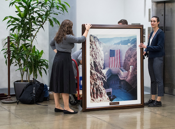 Rep. Jacky Rosen, D-Nev., staffers load a framed photo of the Hoover Dam and other items onto a hand cart as they make their way to her new office in the Dirksen Senate Office building on Tuesday, Nov. 27, 2018. Rep. Rosen will be Nevada's new junio Senator after defeating Sen. Dean Heller, R-Nev. (Photo By Bill Clark/CQ Roll Call)