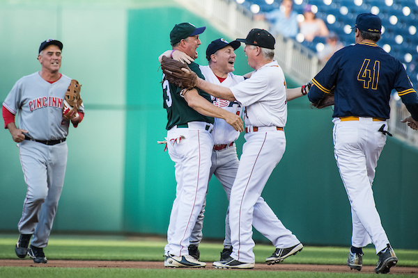 UNE 14: House Majority Whip Steve Scalise, R- La., is congratulated by teammates after throwing out the first runner of the night during the 57th annual Congressional Baseball Game at Nationals Park on June 14, 2018. Scalise was critically wounded in last year's Republican baseball practice shooting. Appearing from left, are Reps. Brad Wenstrup, R-Ohio, Jeff Duncan, R-S.C., Scalise, Mo Brooks, R-Ala., and Mark Walker, R-N.C. The Democrats prevailed 21-5. (Photo By Tom Williams/CQ Roll Call)