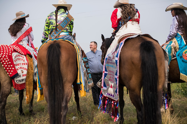AUGUST 19: Sen. Jon Tester, D-Mont., talks with constituents before a parade at Crow Fair in Crow Agency, Mont., on August 19, 2018. Tester is being challenged by Republican Matt Rosendale for the Senate seat. (Photo By Tom Williams/CQ Roll Call)