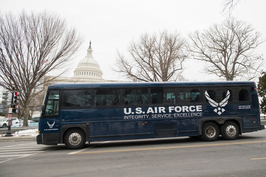 A bus is seen on Independence Avenue after dropping members off on Capitol Hill following the cancellation by President Trump on Thursday of an overseas CODEL. (Tom Williams/CQ Roll Call)