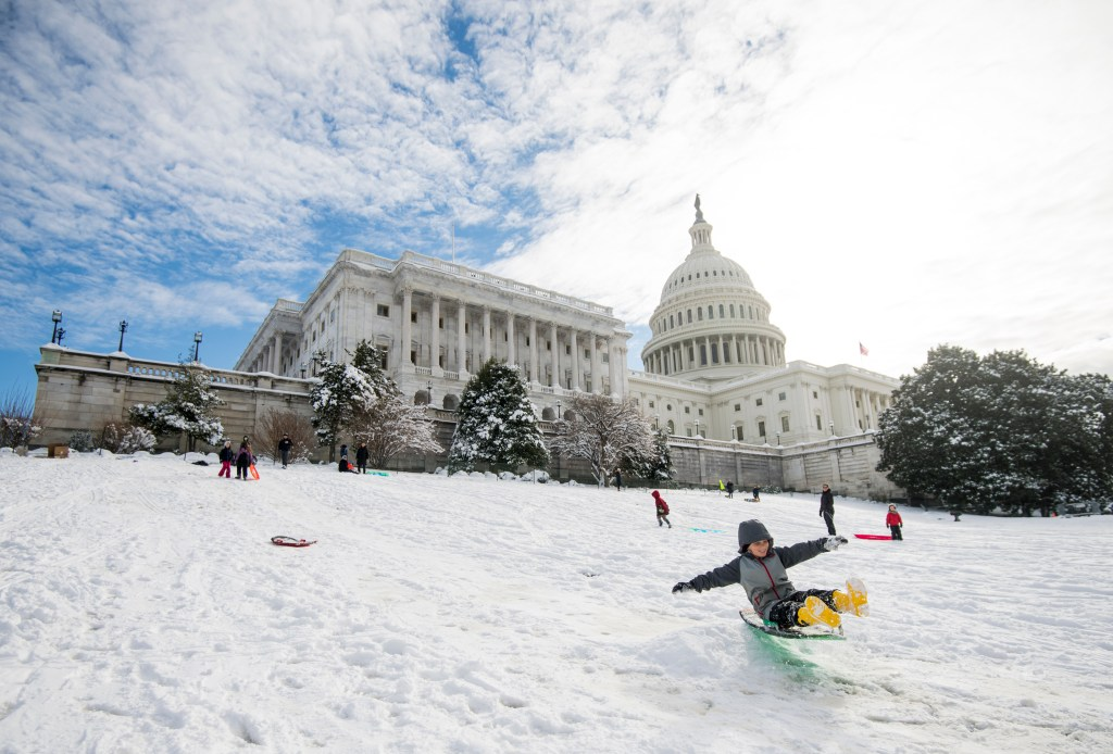 UNITED STATES - JANUARY 14: Kids sled down the hill on the west side of the U.S. Capitol building on Monday, Jan. 14, 2018. (Photo By Bill Clark/CQ Roll Call)