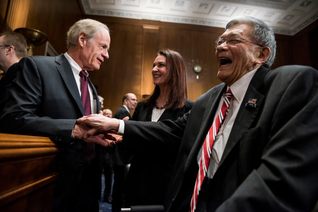UNITED STATES - JANUARY 29: From left, ranking member Sen. Tom Carper, D-Del., Nicole Nason, nominee to be administrator of the Federal Highway Administration, and Norman Mineta, former Secretary of Transportation, talk before the start of the Senate Environment and Public Works Committee hearing on the nomination of Nicole Nason to be administrator of the Federal Highway Administration on Tuesday, Jan. 29, 2018. (Photo By Bill Clark/CQ Roll Call)