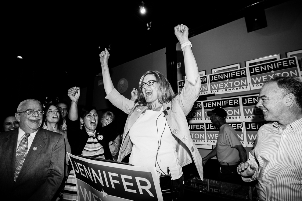 Jennifer Wexton, center, speaks flanked by Rep. Gerry Connolly, D-Va., left, and Sen. Tim Kaine, D-Va., at her primary election night party at O'Faolin's Irish Pub in Sterling, Va., on Tuesday, June 12, 2018. Wexton won the primary to face incumbent Rep. Barbara Comstock, R-Va., in Virginia's 10th Congressional district. (Photo By Bill Clark/CQ Roll Call)