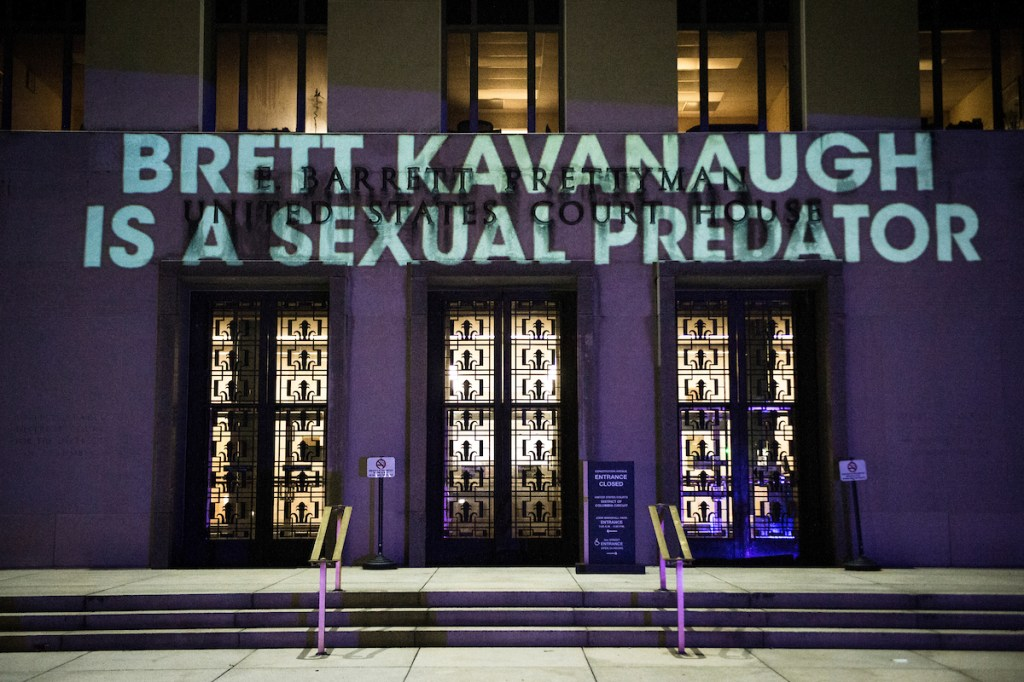Anti-Brett Kavanaugh messages projected on the United States Court of Appeals Tuesday Sept. 25, 2018. (Photo By Sarah Silbiger/CQ Roll Call)