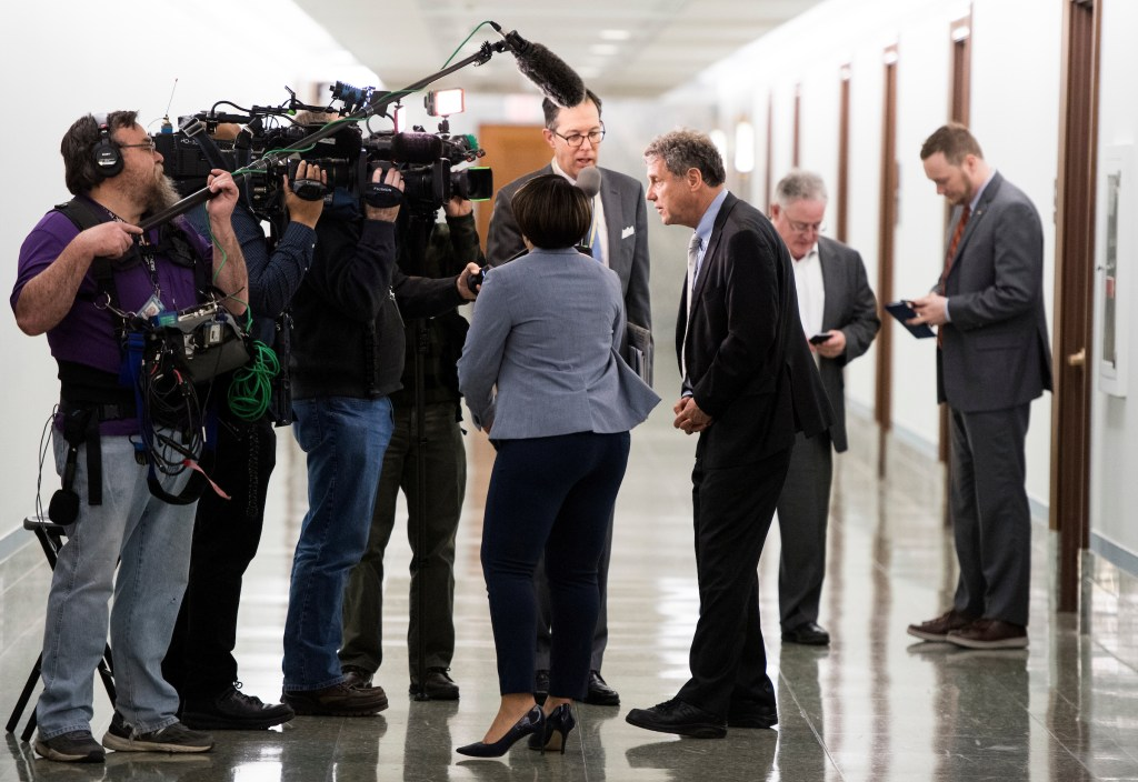 UNITED STATES - MARCH 14: Sen. Sherrod Brown, D-Ohio, stops to speak to the cameras in a hallyway in the Dirksen Senate Office Building on Thursday, March 14, 2019. (Photo By Bill Clark/CQ Roll Call)