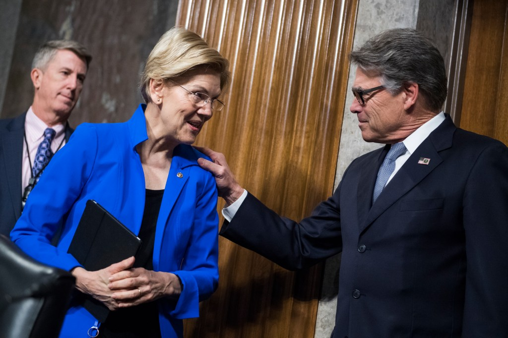 UNITED STATES - MARCH 28: Energy Secretary Rick Perry greets Sen. Elizabeth Warren, D-Mass, before Senate Armed Committee confirmation hearing titled