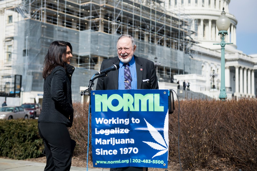 UNITED STATES - MARCH 7: Rep. Tulsi Gabbard, D-Hawaii, and Rep. Don Young, R-Alaska, hold a news conference outside of the Capitol to discuss the introduction of two bipartisan marijuana bills on Thursday, March 7, 2019. (Photo By Bill Clark/CQ Roll Call)