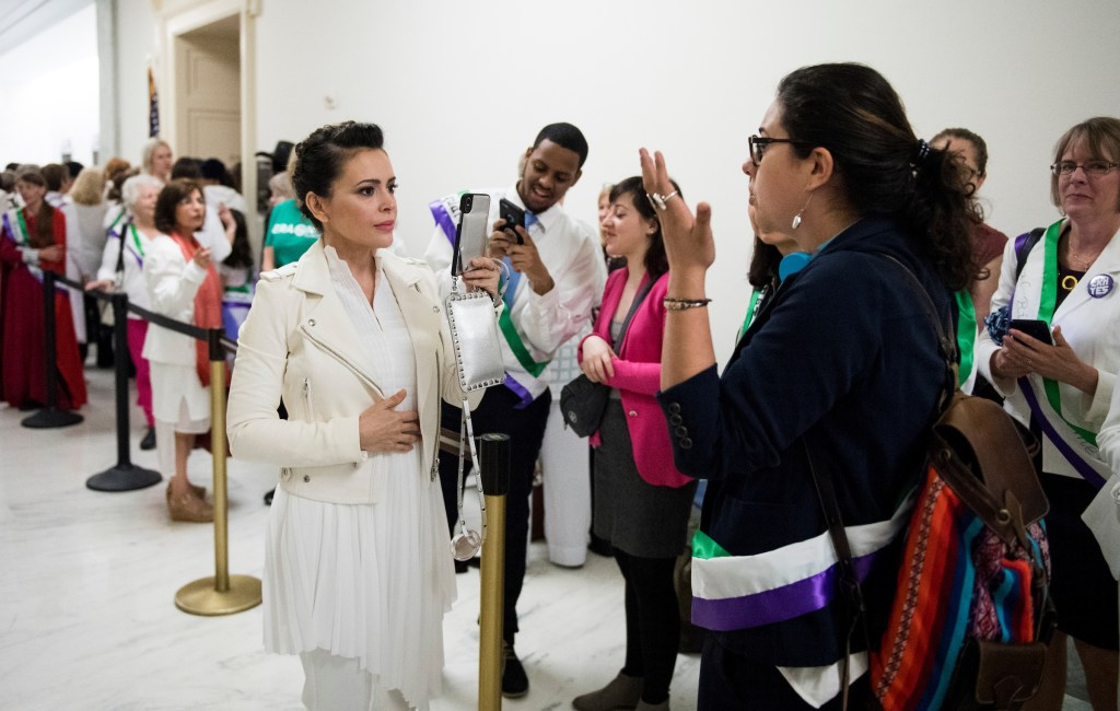 UNITED STATES - APRIL 30: Actress Alyssa Milano, using live twitter video, speaks with ERA activists waiting to enter the House Judiciary Constitution, Civil Rights and Civil Liberties Subcommittee hearing on the Equal Rights Amendment on Tuesday, April 30, 2019. (Photo By Bill Clark/CQ Roll Call)
