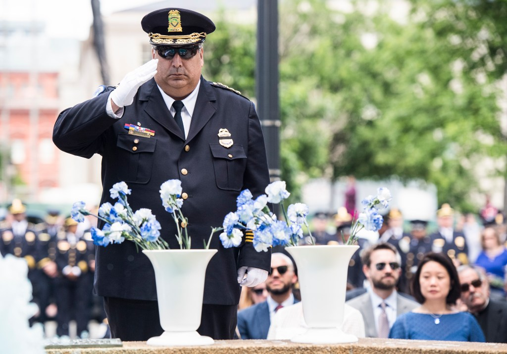 UNITED STATES - MAY 6: U.S. Capitol Police Chief Matthew Verderosa salutes after placing flowers in honor of fallen police officer during the Washington Area Law Enforcement Memorial Service on Monday, May 6, 2019. (Photo By Bill Clark/CQ Roll Call)