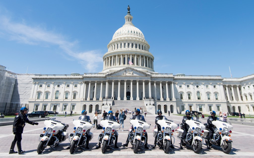 UNITED STATES - MAY 15: U.S. Capitol Police officers with the Patrol Mobile Response Division line up for a group photo in front of the Capitol as Police Week activities continue on Wednesday, May 15, 2019. (Photo By Bill Clark/CQ Roll Call)