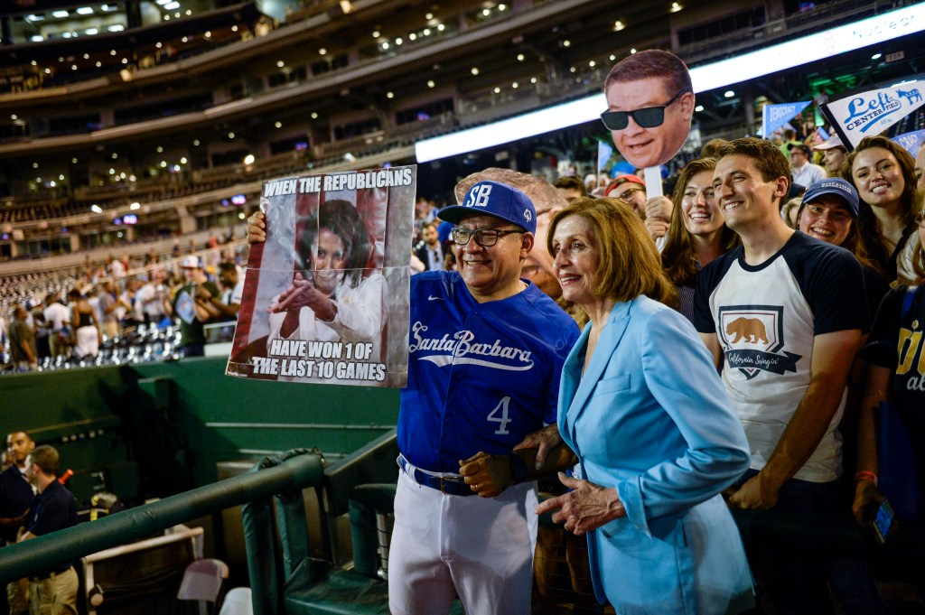 UNITED STATES - JUNE 26: Rep. Salud Carbajal, D-Calif., left, and Speaker of the House Nancy Pelosi, D-Calif., pose with fans after the end of the 58th annual Congressional Baseball Game at Nationals Park on Wednesday June 26, 2019. (Photo by Caroline Brehman/CQ Roll Call)
