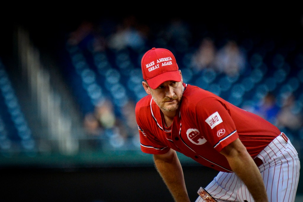 UNITED STATES - JUNE 26: Rep. Greg Steube, R-Fla., wears a Make America Great Again hat as he pitches during the 58th annual Congressional Baseball Game at Nationals Park on Wednesday June 26, 2019. (Photo by Caroline Brehman/CQ Roll Call)