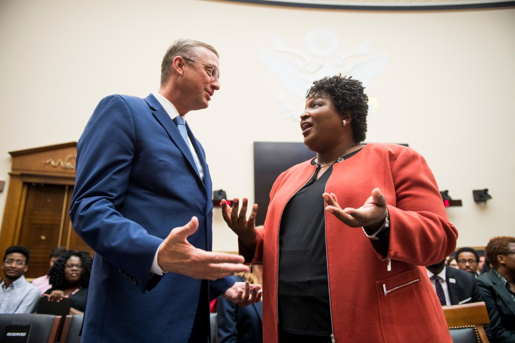 UNITED STATES - JUNE 25: Stacey Abrams, former Democratic leader in the Georgia House of Representatives and founder and chair of Fair Fight Action, speaks with ranking member Rep. Doug Collins, R-Ga., before the start of the House Judiciary Subcommittee on Constitution, Civil Rights and Civil Liberties hearing on the Voting Rights Act on Tuesday, June 25, 2019. (Photo By Bill Clark/CQ Roll Call)