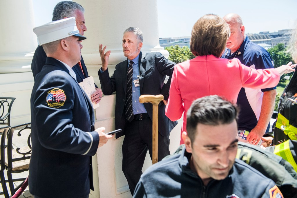 UNITED STATES - JUNE 11: Comedian and advocate Jon Stewart, center, talks with Rep. Peter King, R-N.Y., on the Speaker's balcony after a meeting in the Capitol about funding for the September 11th Victim Compensation Fund on Tuesday, June 11, 2019. 9/11 responders attended the meeting. (Photo By Tom Williams/CQ Roll Call)