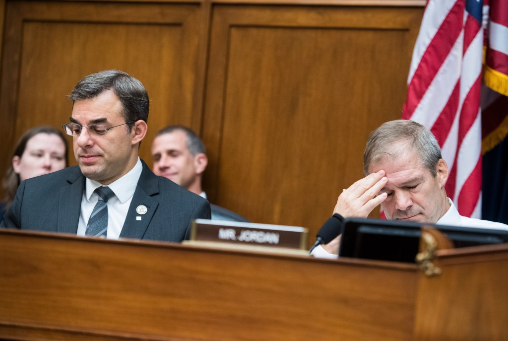 UNITED STATES - JUNE 12: Reps. Justin Amash, R-Mich., left, and ranking member Rep. Jim Jordan, R-Ohio, are seen during a House Oversight and Reform Committee markup in Rayburn Building on a resolution on whether to hold Attorney General William Barr and Secretary of Commerce Wilbur Ross in contempt of Congress on Wednesday, June 12, 2019. (Photo By Tom Williams/CQ Roll Call)