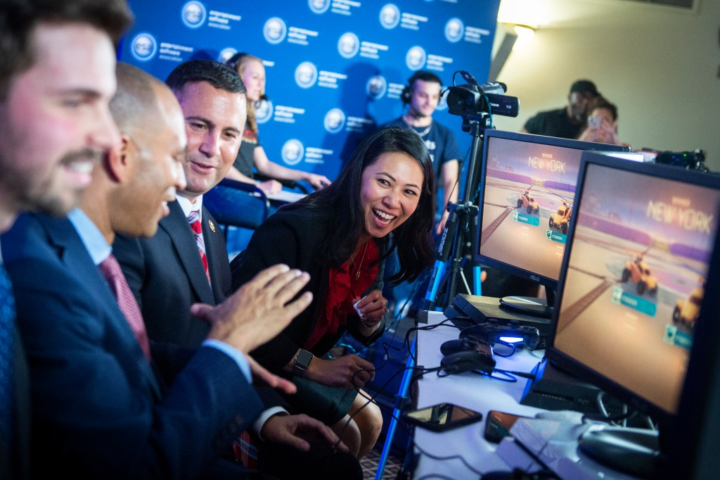 UNITED STATES - JULY 10: Rep. Stephanie Murphy, D-Fla., right, Rep. Darren Soto, D-Fla., and Democratic Caucus Chair Hakeem Jeffries, D-N.Y., play each other in a video game during an educational event on esports on Capitol Hill on Wednesday July 10, 2019. (Photo by Caroline Brehman/CQ Roll Call)