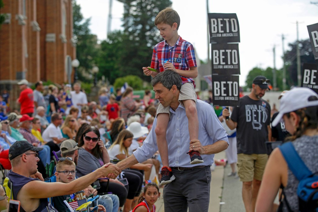 After former Texas Rep. Beto O'Rourke lost his bid to oust Sen. Ted Cruz last year, he set his sights on the presidency. Above, O'Rourke campaigns in Independence, Iowa, with his son Henry.(Joshua Lott/Getty Images)