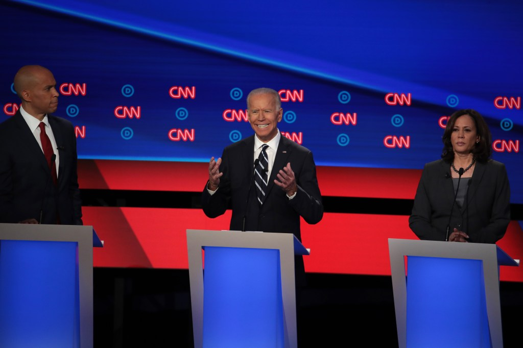 Former Vice President Joe Biden speaks while Sens. Kamala Harris of California and Cory Booker of New Jersey listen during the Democratic presidential debate Wednesday in Detroit. (Scott Olson/Getty Images)