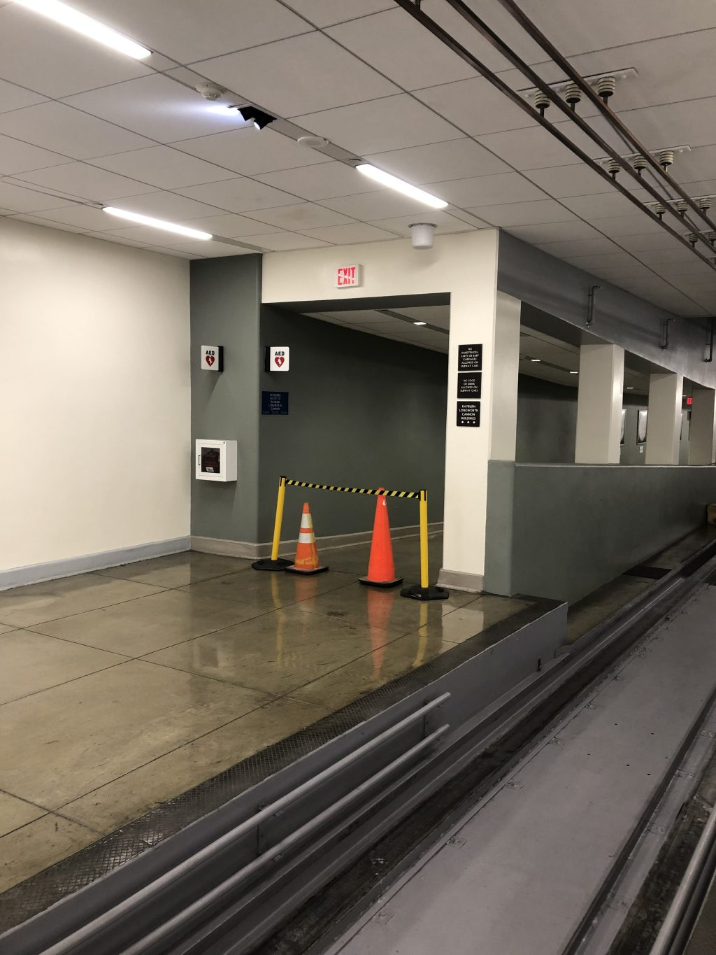 The pedestrian walkway in the Rayburn tunnel that connects to the Capitol flooded due to heavy rain Monday.