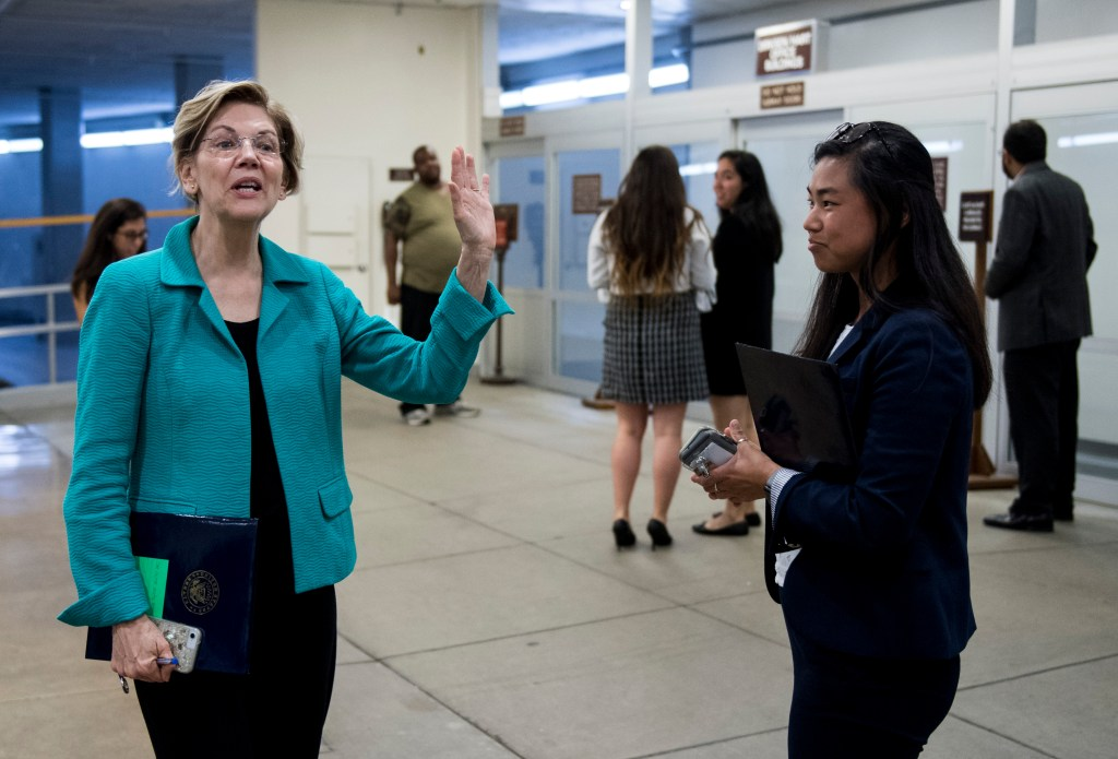 UNITED STATES - JULY 10: Sen. Elizabeth Warren, D-Mass., comments to reporters as she leaves the closed briefing on election security in the Capitol on Wednesday, July 10, 2019. (Photo By Bill Clark/CQ Roll Call)