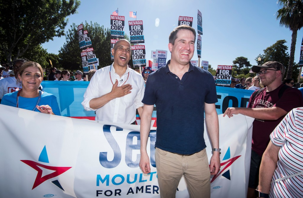 UNITED STATES - JULY 4: Presidential candidate Sen. Cory Booker, D-N.J., speaks with fellow candidate Rep. Seth Moulton, D-Mass., before the start of the Boulder City Damboree Celebration 4th of July parade in Boulder City, NV on July 4, 2019. (Photo By Bill Clark/CQ Roll Call)