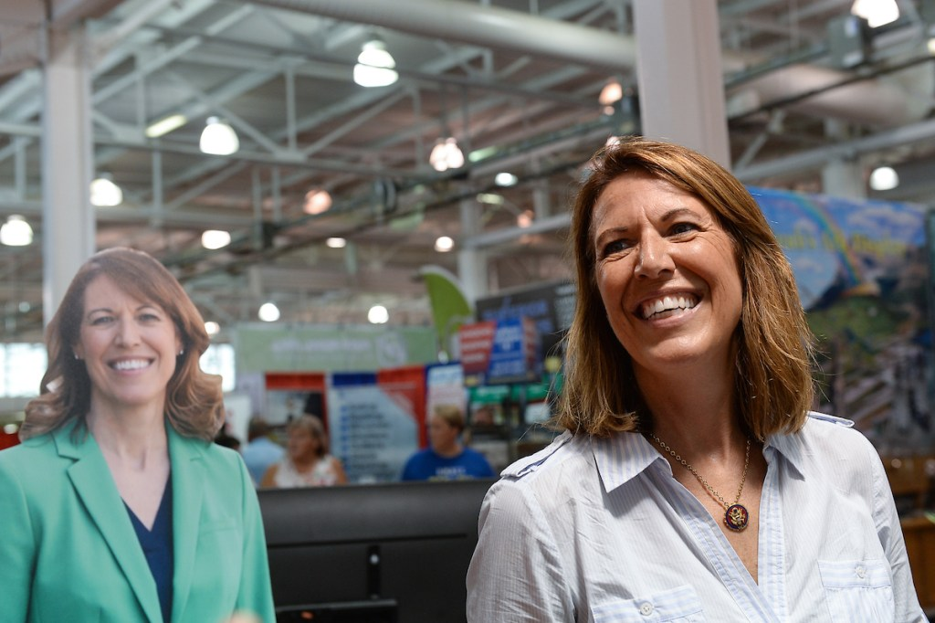 Rep. Cindy Axne, D-Iowa, talks with fairgoers at the Iowa Democratic Party booth. (Caroline Brehman/CQ Roll Call)