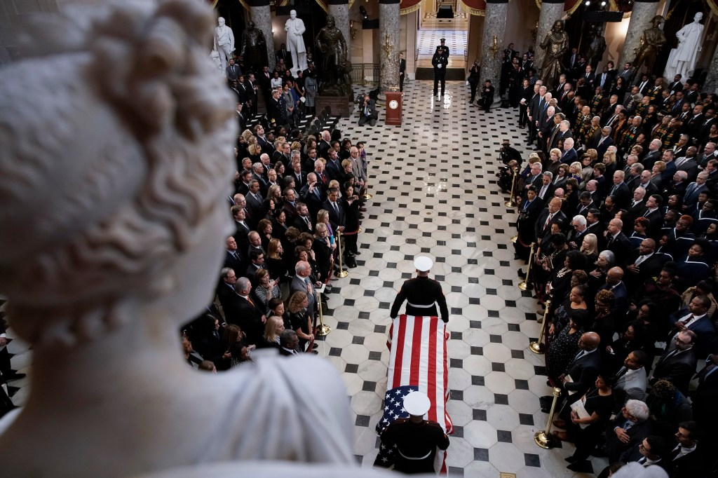 WASHINGTON, DC - OCTOBER 24: The flag-draped casket of U.S. Rep. Elijah Cummings (D-MD) is escorted by a military honor guard to National Statuary Hall in the U.S. Capitol for a memorial service October 24, 2019 in Washington, DC. Rep. Cummings passed away on October 17, 2019 at the age of 68 from