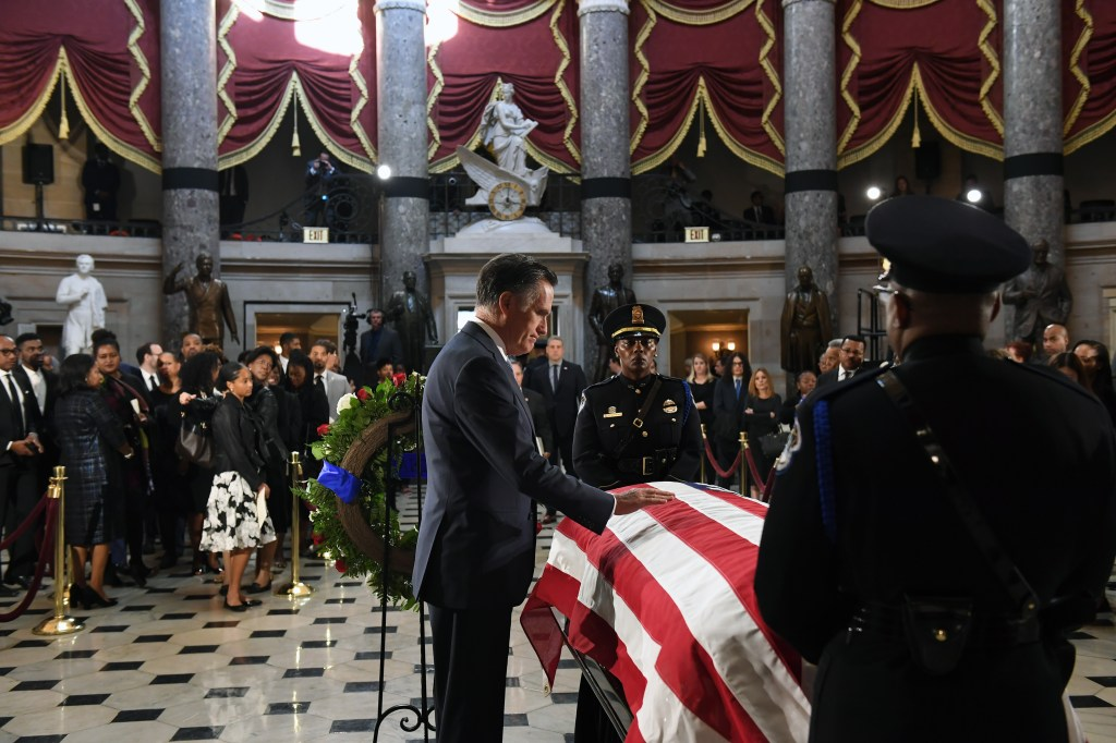 WASHINGTON, DC - OCTOBER 24: Senator Mitt Romney (R-UT) pays his respects to Congressman Elijah Cummings (D-MD) in National Statuary Hall at the United States Capitol on Thursday October 24, 2019 in Washington, DC. The service preceded Cummings lying in state in front of the House chambers. (Photo by Matt McClain-Pool/Getty Images)