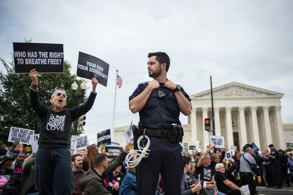 UNITED STATES - OCTOBER 8: Protesters block the street in front of the Supreme Court as it hears arguments on whether gay and transgender people are covered by a federal law barring employment discrimination on the basis of sex on Tuesday, Oct. 8, 2019. (Photo by Caroline Brehman/CQ Roll Call)
