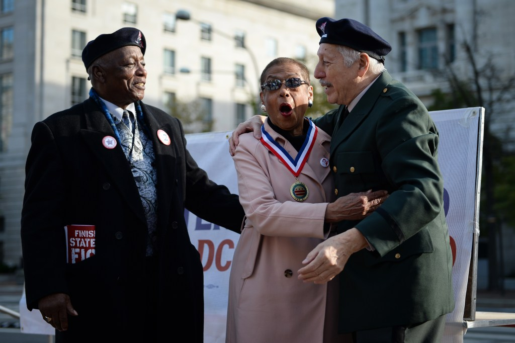 """UNITED STATES - NOVEMBER 11: Del. Eleanor Holmes Norton, D-D.C., center, receives the """"DC Statehood Freedom Award"""" for her work fighting for D.C. equality at a rally sponsored by Veterans for D.C. Statehood on Veterans Day at Freedom Plaza on Monday Nov. 11, 2019. (Photo by Caroline Brehman/CQ Roll Call)"""