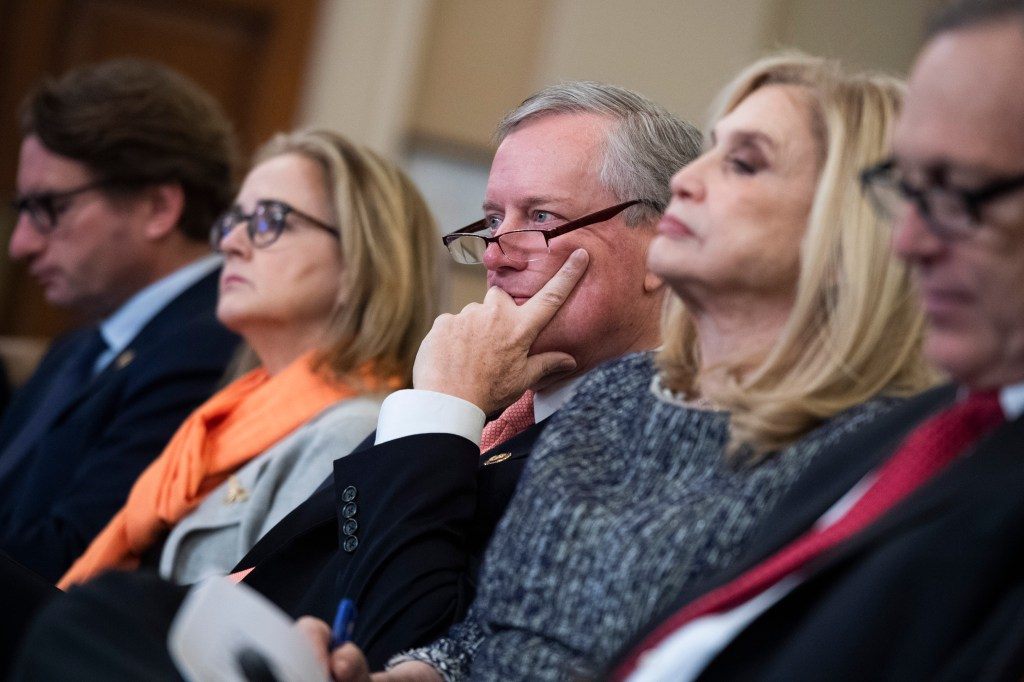 UNITED STATES - NOVEMBER 21: From left, Reps. Dean Phillips, D-Minn., Madeleine Dean, D-Pa., Mark Meadows, R-N.C., Carolyn Maloney, D-N.Y., and Andy Biggs, R-Ariz., sit in the audience during the House Intelligence Committee hearing on the impeachment inquiry of President Trump in Longworth Building on Thursday, November 21, 2019. Fiona Hill, former National Security Council Russia adviser, and David Holmes, counselor for political affairs at the U.S. Embassy in Ukraine, testified. (Photo By Tom Williams/CQ Roll Call)