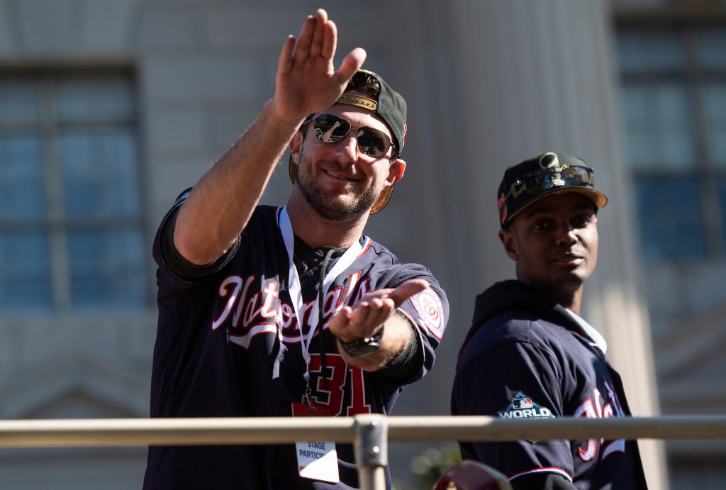 UNITED STATES - NOVEMBER 02: Washington Nationals pitcher Max Scherzer does a shark chomp on 15th St., NW, during a parade to celebrate the World Series champions on Saturday, November 2, 2019. (Photo By Tom Williams/CQ Roll Call)