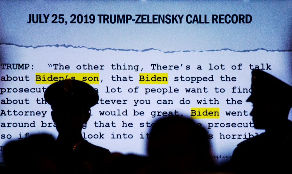 UNITED STATES - NOVEMBER 19: A quote is displayed on a monitor from a phone call between President Donald Trump and Ukrainian President, Volodymyr Zelensky as Lt. Col. Alexander Vindman, director of European affairs at the National Security Council, and Jennifer Williams, an aide to Vice President Mike Pence, testify during the House Intelligence Committee hearing on the impeachment inquiry of President Trump in Longworth Building on Tuesday, November 19, 2019. (Photo by Caroline Brehman/CQ Roll Call)