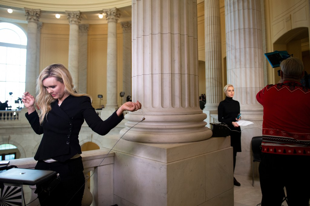 Broadcast news reporters gather in the Cannon rotunda as the House takes up articles of impeachment against President Donald Trump on Wednesday. (Caroline Brehman/CQ Roll Call)