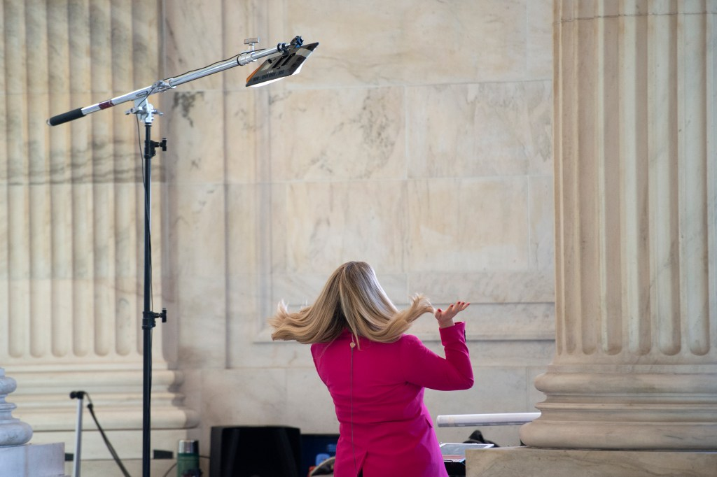 UNITED STATES - JANUARY 22: A television reporter gets ready before going on-camera in the Russell Rotunda on Wednesday, Jan. 22, 2020. (Photo by Caroline Brehman/CQ Roll Call)