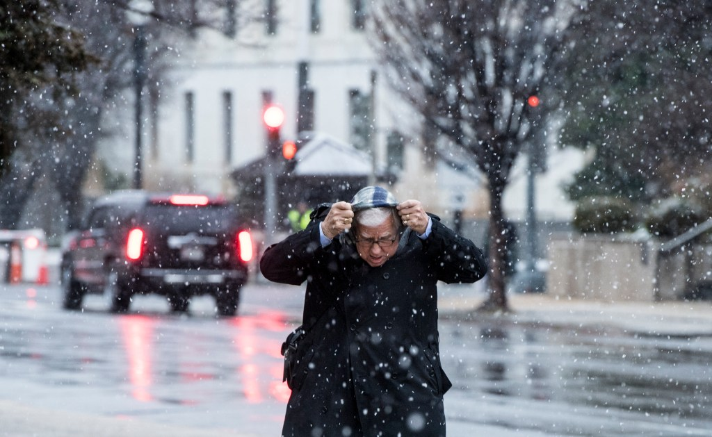 UNITED STATES - JANUARY 7: Sen. Mike Enzi, R-Wyo., takes a walk in the snow outside the Capitol on Tuesday, Jan. 7, 2020. A brief snowstorm passed through Washington in the afternoon forcing the federal goverment to close early. (Photo By Bill Clark/CQ Roll Call)