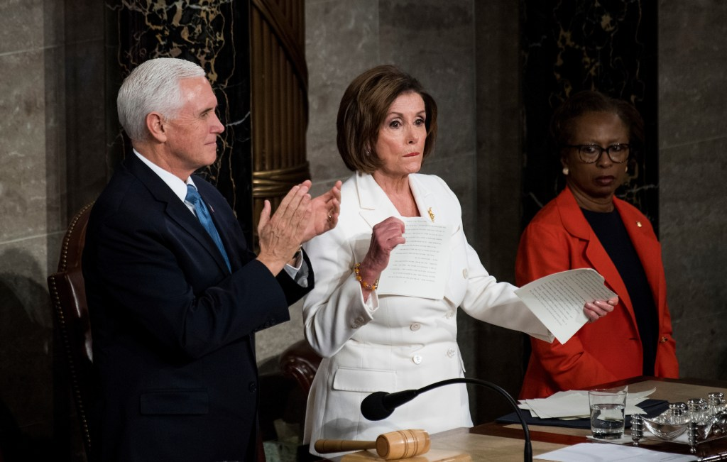 UNITED STATES - FEBRUARY 04: Vice President Mike Pence claps while Speaker of the House Nancy Pelosi, D-Calif., rips up a copy of President Donald Trump's State of the Union address at the conclusion of his address to a joint session of Congress on Tuesday, February 4, 2020. (Photo by Caroline Brehman/CQ Roll Call)