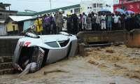 The vehicle washed away by the Flood at the Bridge near Amegashie House