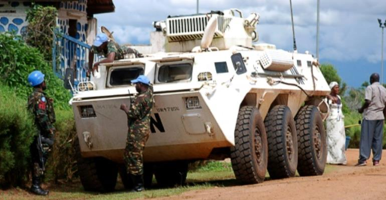 Rebels from a Ugandan-dominated group attacked a UN military base in DR Congo's unstable east, killing one peacekeeper and injuring 12 others, the UN mission said.  By ALAIN WANDIMOYI (AFP/File)