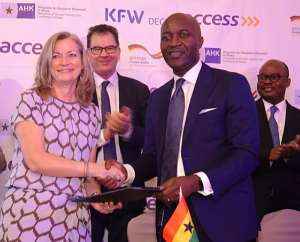 Ms. Laibach & Mr. Ogbonna exchange MOU with Dr. Müller  And Dr. Addison Applauding