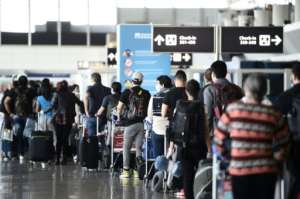 Italian authorities fear holidaymakers may be bringing the virus back with them.  By Filippo MONTEFORTE (AFP/File)
