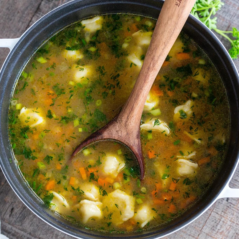 Pelmeni soup in a pot